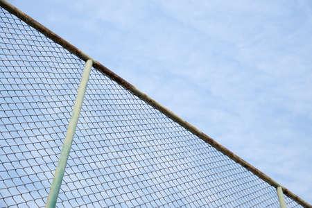 rusty steel grille fence with sky background. Reklamní fotografie