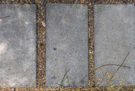 top view of walkway rectangle stone cement sheet with gravel and leaf in the garden.