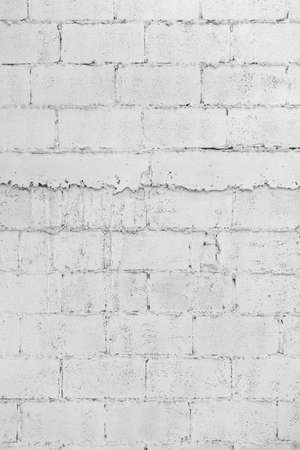 close up of white decay brick wall abstract background wallpaper or web banner with copy space.