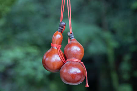 a hanging red Japanese Hyotan gourd with calabash shape, amulet or accessories for fortune. Imagens