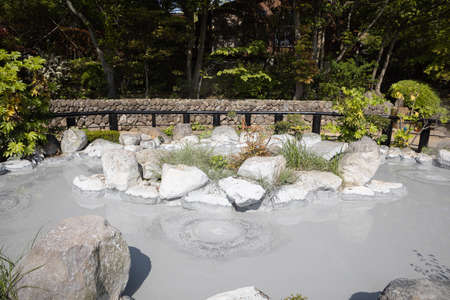 landscape view of gray mud boiling bubble hot springs at Japan. Stok Fotoğraf