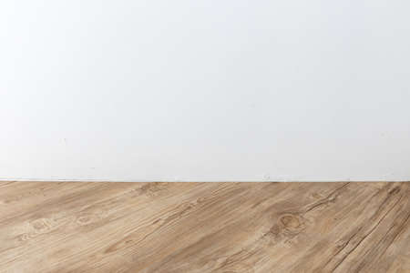 perspective view of empty interior room with white cement wall and brown wooden herringbone plank floor. Stock fotó