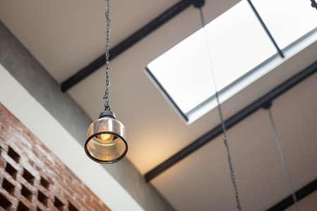 Hanging vintage ceiling yellow lamp interior at daytime.