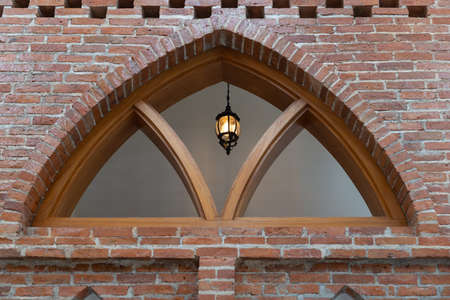 Arch antique facade of brick wall and wooden architecture.
