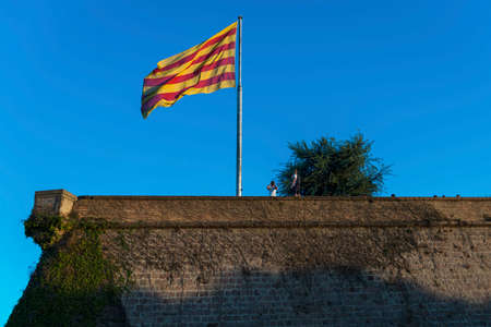 Senyera flag at Montjuic Castle in Barcelona signifies Catalonian desire to independence from Spain. Reklamní fotografie