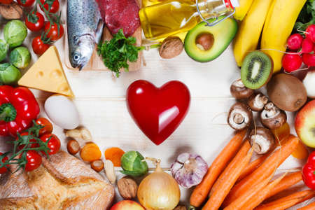 Healthy lifestyle and healthcare concept. Healthy food and heart on table