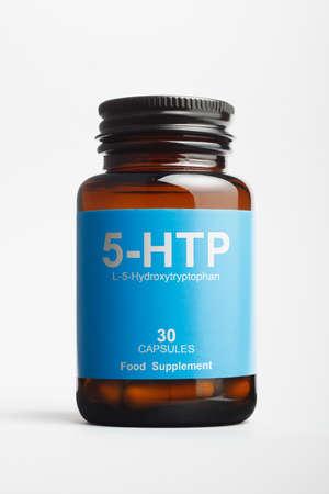 5-HTP bottle with L-5-Hydroxytryptophan, precursor of serotonin.