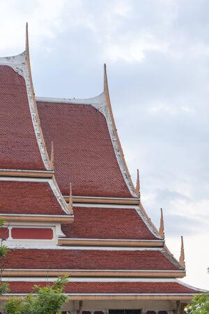 Thai art on roof Church at Thai temple. with sky photo
