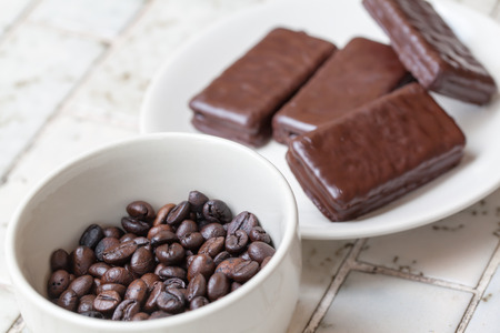 chocolate bars on white plate with Cup of coffee beans photo
