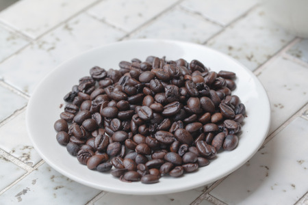 coffee grounds: pour coffee grounds into the plant on mable Stock Photo