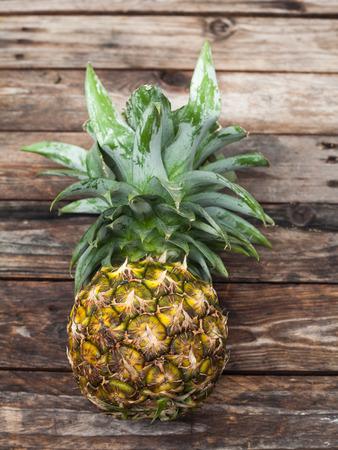 wood table: Fresh whole pineapple on wood table