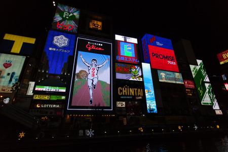 well known: OSAKA, JAPAN - NOVEMBER 24: The Glico Man billboard and other light displays on November 24, 2014 in Dontonbori, Namba Osaka area, Osaka, Japan. Namba is well known as an entertainment area in Osaka.