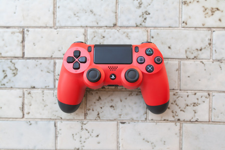 THAILAND - AUGUST 12: the new sony dualshock 4 controller for PlayStation 4 taken in BANGKOK THAILAND on 12 August 2014.