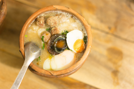 mush: mush pork and Eggs rice soup in Clay pot thai style Stock Photo