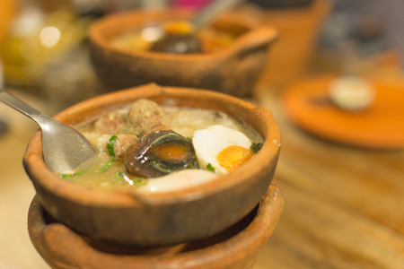 clay pot: mush pork and Eggs rice soup in Clay pot thai style Stock Photo