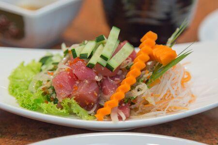 Close up Salmon Sashimi in Spicy Hot Sauce Japan Food