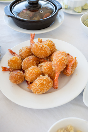 batter-fried prawns in white plate on food table 写真素材