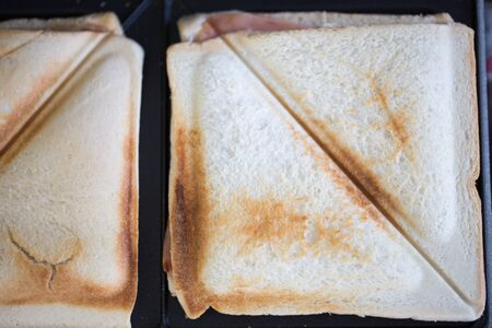 Homemade baked sandwich in Toaster, close up