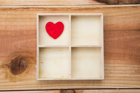 left ventricle: The heart is a house with four rooms concept on wood background Stock Photo