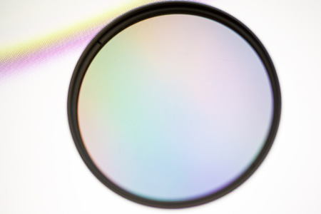 cpl: Amazing color of white light that passes through the clear plastic, water drops and CPL filters. Stock Photo