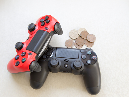 joy pad: THAILAND - Feb 6 : The new sony dualshock 4 red and black color controller for PlayStation 4 taken and money japan coin, Mark money by game Concept in BANGKOK THAILAND on 6 Feb 2016 Editorial