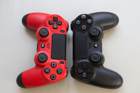 joypad: THAILAND - Feb 6 : The new sony dualshock 4 red and black color controller for PlayStation 4 taken, VS Concept in BANGKOK THAILAND on 6 Feb 2016