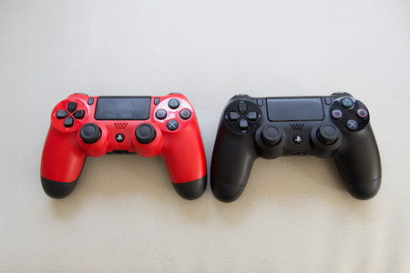 joy pad: THAILAND - Feb 6 : The new sony dualshock 4 red and black color controller for PlayStation 4 taken, VS Concept in BANGKOK THAILAND on 6 Feb 2016