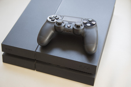 joy pad: THAILAND - FEB 6 : the new sony dualshock 4 controller and new PlayStation 4 in BANGKOK THAILAND on 6 FEB 2016.