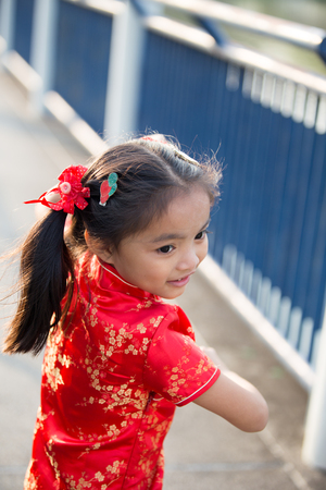 asian art: Beautiful Asian kids girl with Chinese traditional dress Cheongsam ( Learn chinese martial art ) Stock Photo