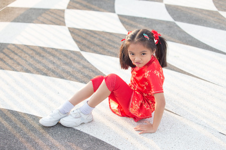 keen: Beautiful Asian kids girl with Chinese traditional dress Cheongsam smile