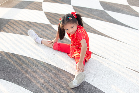 straddle: Beautiful Asian kids girl with Chinese traditional dress Cheongsam ( Seated Wide Legged Straddle )