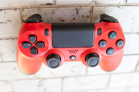 joy pad: THAILAND - Jan 4: The new sony dualshock 4 red color controller for PlayStation 4 taken in BANGKOK THAILAND on 4 Jan 2016 Editorial