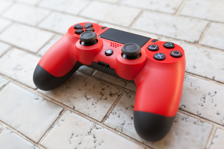 joypad: THAILAND - Jan 4: The new sony dualshock 4 red color controller for PlayStation 4 taken in BANGKOK THAILAND on 4 Jan 2016 Editorial