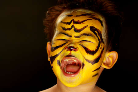 painting face: Tiger Boy Stock Photo