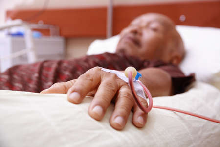 blood transfusion on a hand of an old man Stock Photo