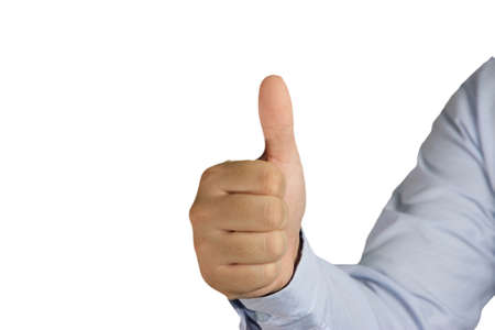 male businessman showing thumb up gesture against white background Stock Photo