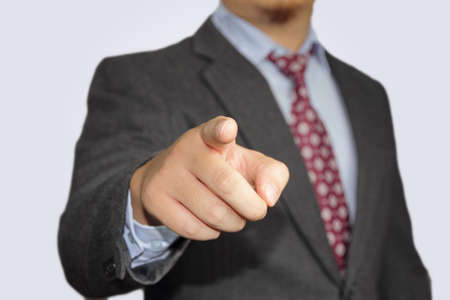 male businessman pointing his finger to the front photo