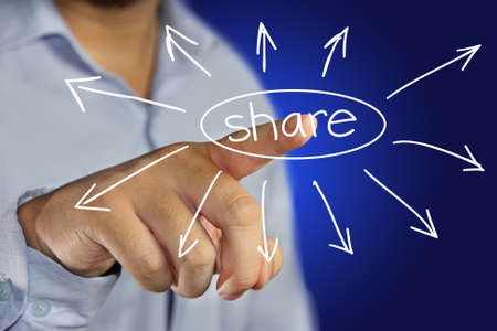 male businessman pointing finger to click share icon on virtual display photo