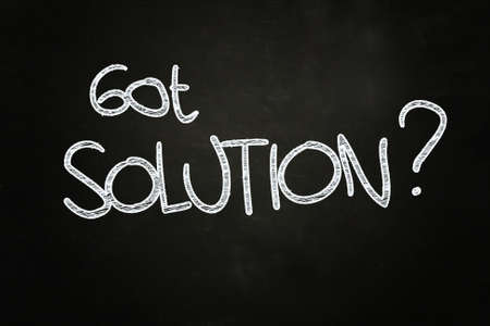 solve a problem: got solution  quote written with chalk on blackboard Stock Photo