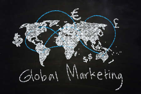 global marketing concept drawn with chalk on blackboard Stock Photo - 24613456