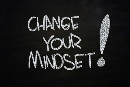 change your mindset written with chalk on blackboard photo