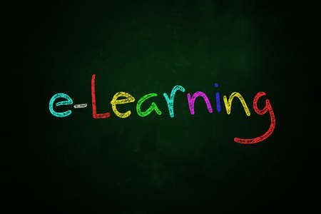 e-learning word written with color chalk on blackboard Stock Photo - 24613465