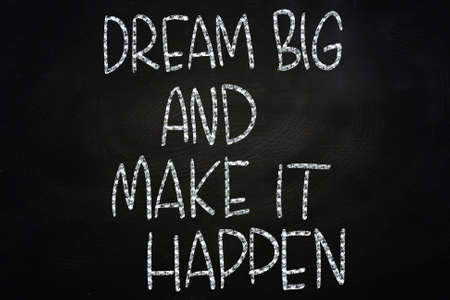 Dream Big and Make It Happen, Motivational Phrase Written on Blackboard photo