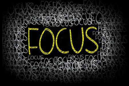 Focus Words written with Chalk on Blackboard