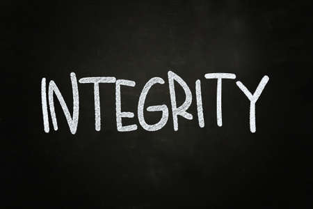 authenticity: Integrity Lettering, written with Chalk on Blackboard Stock Photo