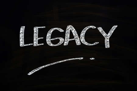 legacy: Legacy Word, written with Chalk on Blackboard Stock Photo