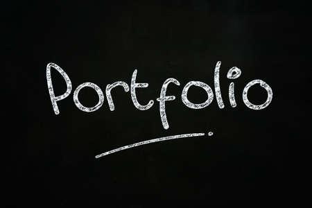 Portfolio Lettering, written with Chalk on Blackboard Stock Photo - 24614943