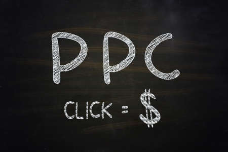 PPC Click Equal Dollar Lettering, written with Chalk on Blackboard photo