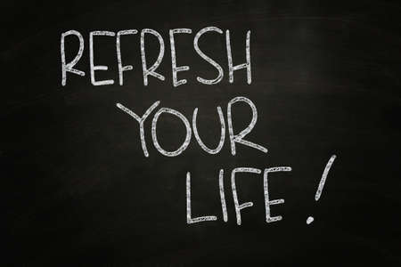 Refresh Your Life, Motivational Phrase written with Chalk on Blackboard photo