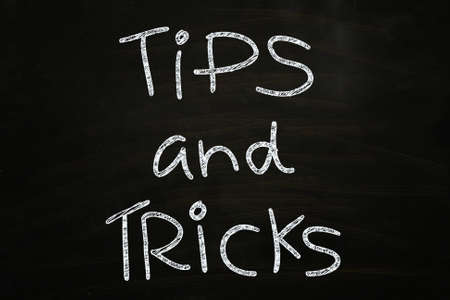 Tips and Tricks Lettering, written with Chalk on Blackboard